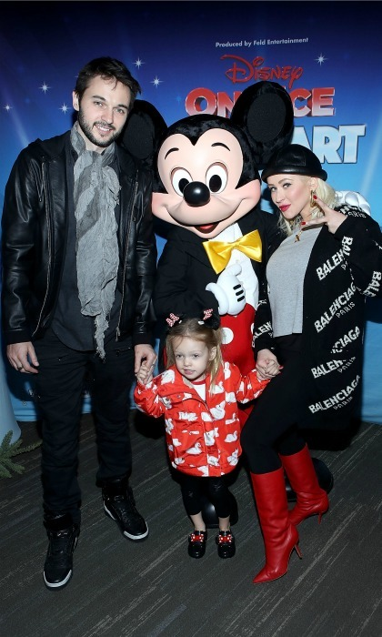 Christina Aguilera brought some Disney magic to her weekend when her and her partner Matthew Rutler took their daughter Summer Rain Rutler, 3, to <i>Disney On Ice: Follow Your Heart</i>. The trio joined Mickey Mouse himself for a photo while at the Staples Center event on December 16 in L.A. 