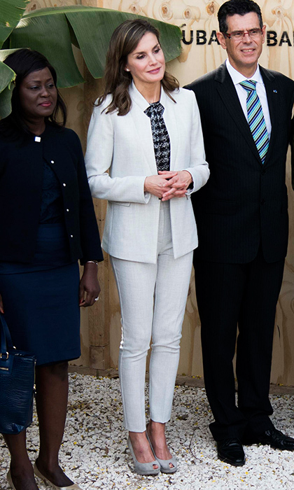 While in Senegal, Queen Letizia also suited up in a linen two-piece as she visited the Cervantes Institute in Dakar. The BOSS Hugo Boss look, teamed with a Carolina Herrera blouse, was recycled – the royal had worn it before in Puerto Rico.