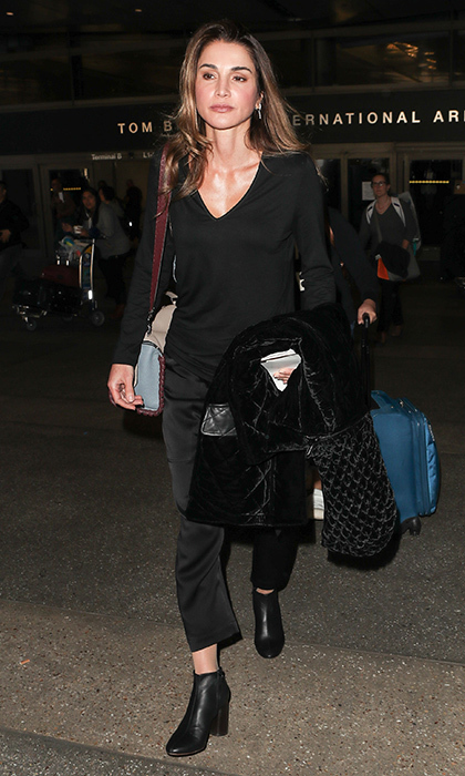 We don't often get a look at Queen Rania of Jordan's street style, but here is the royal keeping it simple in all black, heeled boots and a furry coat as she arrived at LAX.