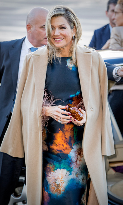 Feathers, watercolor print and a camel coat were the perfect combo for Queen Maxima of the Netherlands as she attended Christmas concert performed by school bands in Rotterdam on December 14. 