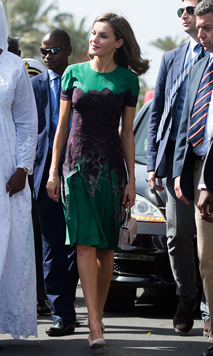 Queen Letizia of Spain wore a green and purple dress by Carolina Herrera to meet First Lady of Senegal Marieme Faye Sall on December 12 in Dakar. The Spanish royal was on a four-day visit to the country. 