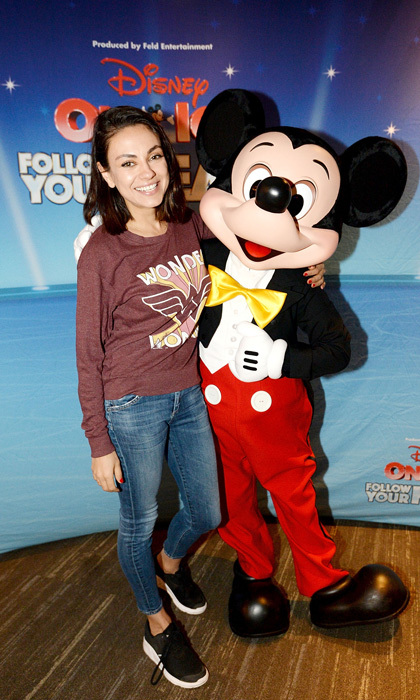 Say cheese! Mila Kunis shared a special moment with Mickey Mouse during her visit to Disney on Ice in L.A. on December 16. The <i>Bad Moms</i> star attended the Follow Your Heart program at the iconic Staples Center with her family, along with Beyoncé, Armie Hammer and Christina Aguilera.