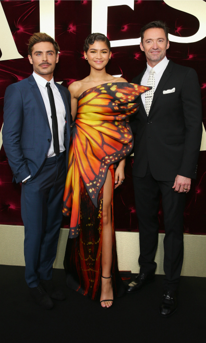 The greatest butterfly! Co-stars Zac Efron, Zendaya and Hugh Jackman posed for photos at the Australian premiere of their new film <i>The Greatest Showman</i> at The Star on December 20 in Sydney. Sandwiched by her two dapper leading men, the 21-year-old starlet made hearts flutter in a show-stopping butterfly dress by Moschino. 