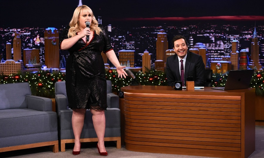 "Deck the Halls? Rebel Wilson brought the laughs to <i>The Tonight Show Starring Jimmy Fallon</i> at Rockefeller Center on December 19 in New York City. The <i>Pitch Perfect 3</i> star and the host sang classic Christmas songs with a twist: they had to use Google translated lyrics. Therefore, Rebel's rendition of <i>Deck the Halls</i> became ""The Homes Are Covered.""