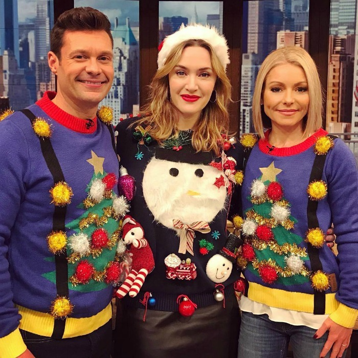 "Ugly Christmas sweater soirée! Ryan Seacrest and Kelly Ripa welcomed Kate Winslet onto their live show on the morning of December 21 for a festive interview. The show's official account shared a behind-the-scenes snap of the three, writing: ""Yaaas! #KateWinslet brought it for our Holiday Sweater Party! #LiveFashionFinder #kellyandryan sweaters provided by @tipsyelves and Kate Winslet's sweater from Etsy 1960VintageMania.""