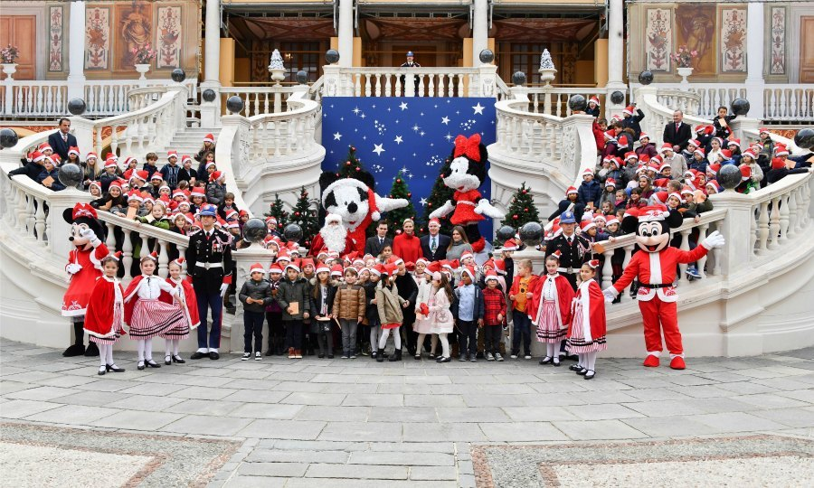 Monaco palace or Disney World? The Monaco royal family made Christmas magical for a lucky group of kids during their annual Christmas ceremony at the palace. Princess Charlene, Prince Albert II, his nephew Daniel Ducruet and niece Camille Gottlieb, showed up to help Mickey, Minnie and, of course, Santa give out gifts to the attendees on December 20.