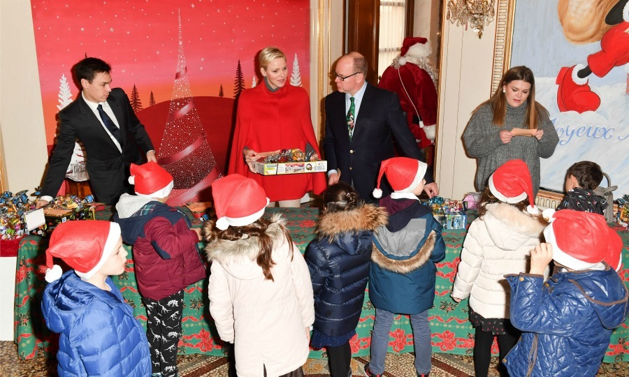 Santa's little helpers! Inside the palace, Monaco's royals Daniel, Charlene, Albert and Camille gave out gifts to the excited kids. The group was made of both Monegasque and refugee children.