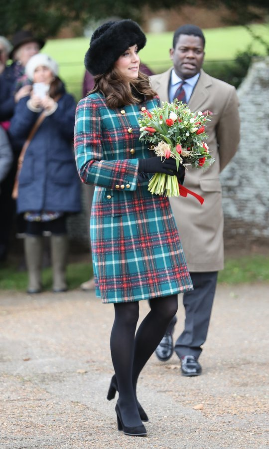 Kate, who is expecting her third child with Prince William, wore a chic $2200 Miu Miu velvet-trimmed double-breasted tartan wool-blend peacoat.
