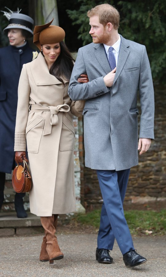 Meghan looked characteristically stylish in a camel coat by Sentarel and suede boots. Instead of a clutch the future royal carried the Chloe 'Pixie' small leather and suede bag which retails for around $1,550.