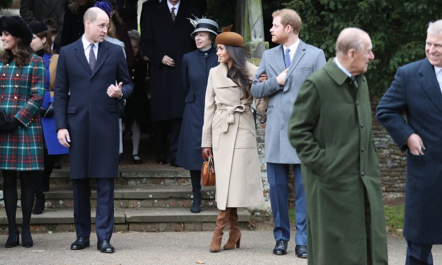 Royal brothers Prince William and Prince Harry had a chat as Meghan looked on while they exited the church. Also seen are Duchess Kate, Princess Anne, and in the foreground, Prince Philip talking to son Prince Andrew. 