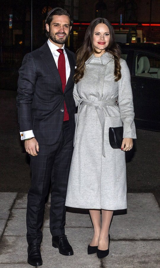 Wrap coats also seem to be a royal fave this season. Joined by husband Prince Carl Philip, Princess Sofia of Sweden wore a cozy grey style for the 'Christmas in Vasastan' concert at Gustav Vasa church on December 21. 