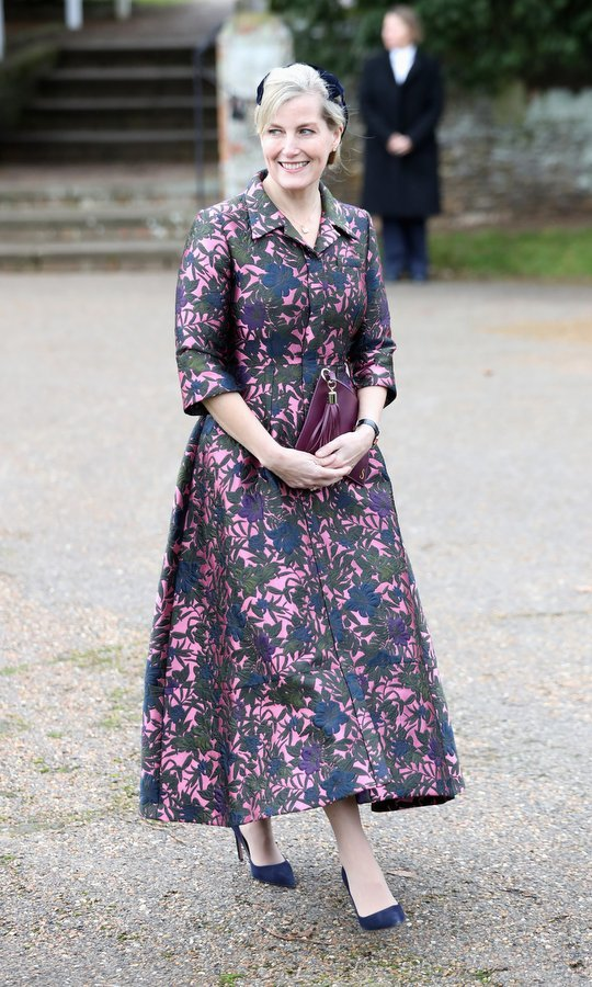 Prince Edward's wife also attended the St Mary Magdalene church service in style. Sophie Wessex opted for a retro look in a 1950s style pink and blue dress by royal fave Erdem, worn with jewel-toned accessories – pumps and a hat in deep blue, and a purple leather clutch with tassel detail.