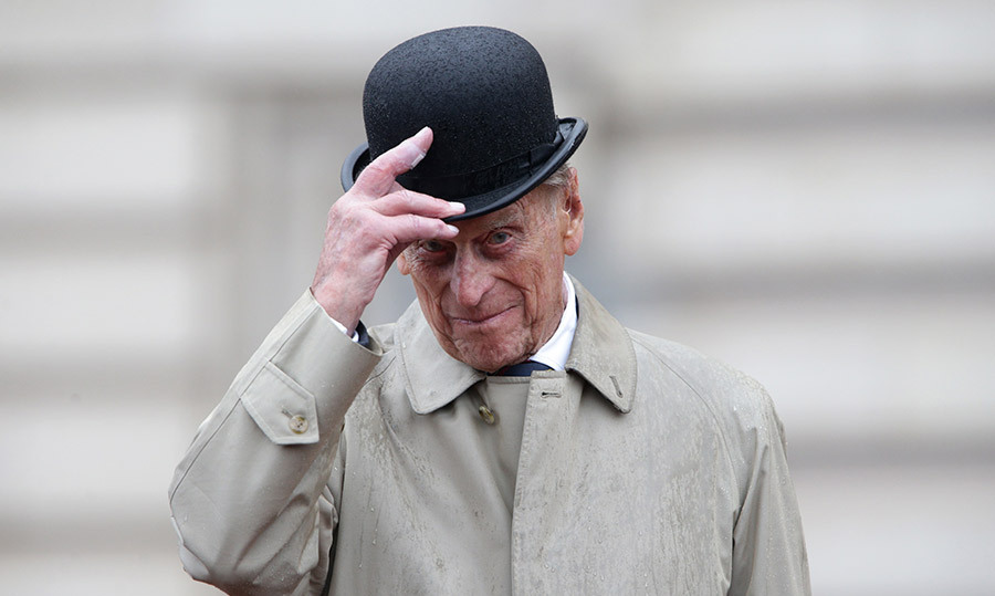 PHILIP HANGS UP HIS HAT