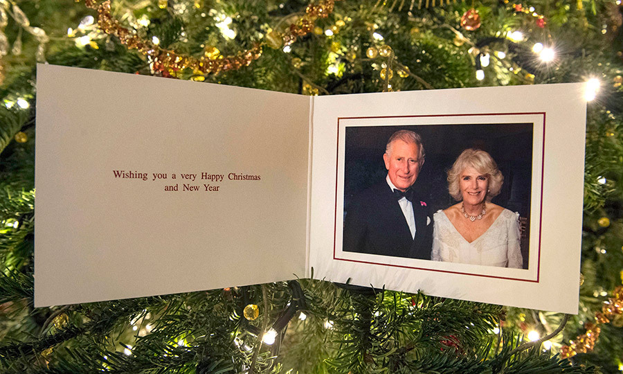 Prince Charles and Duchess Camilla say they're wishing everyone a very Happy Christmas and New Year in their 2017 holiday card. The picture on the card was taken by Hugo Burnand during the Duchess' private 70th birthday party of at Highgrove in July.