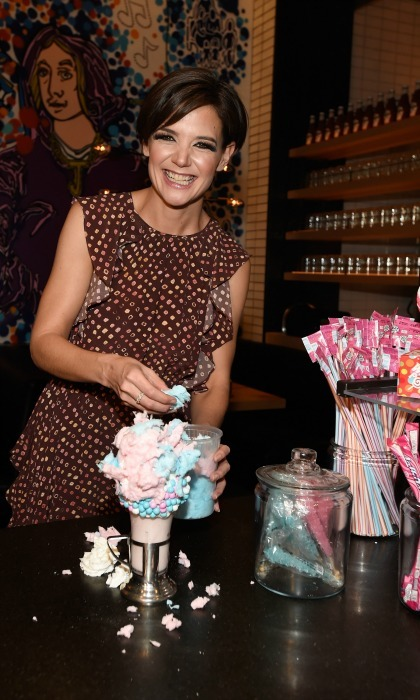 Katie Holmes satisfied her sweet tooth at the grand opening of Black Tap Craft Burgers & Beer at the Venetian Las Vegas on December 29. The 39-year-old star tried out their famous cotton candy milkshake, personalizing it with some extra sugar!