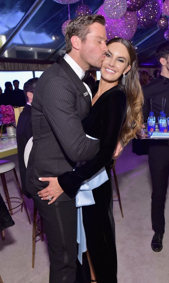 <I>Call Me By Your Name</I> star Armie Hammer embraced wife Elizabeth Chambers at the HFPA's Official soirée. 