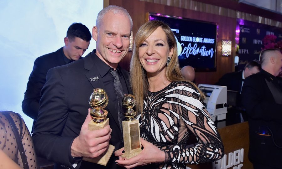 <I>Three Billboards</I> director Martin McDonagh and actress Allison Janney had a twinning trophy moment at at HFPA's Official Viewing and After-Party, also sponsored by FIJI water, at the Wilshire Garden inside The Beverly Hilton. Winners from the evening enjoyed Lindor milk chocolate truffles at the trophy engraving station.