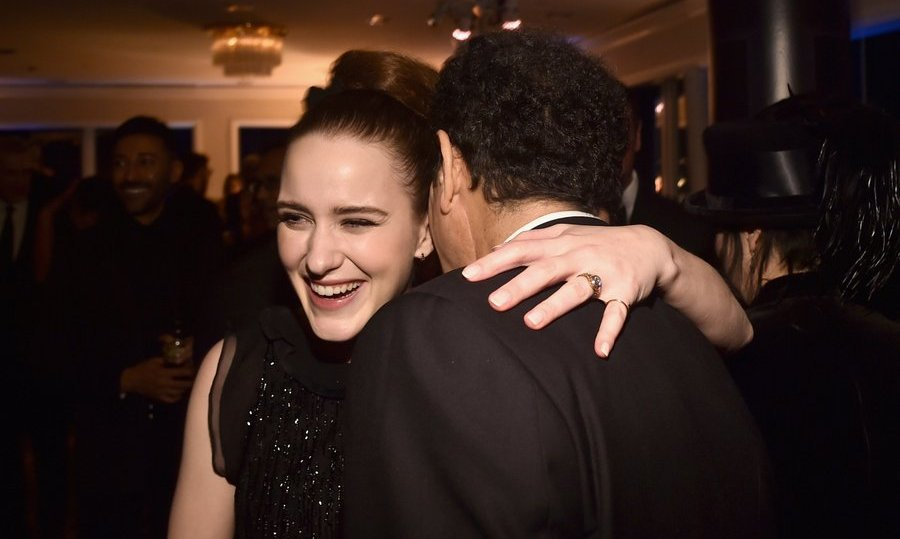 A triumphant Rachel Brosnahan, who took home a globe for her leading role on Amazon's <I>The Marvelous Mrs. Maisel</I>, got a congratulatory hug from  Tony Shalhoub.