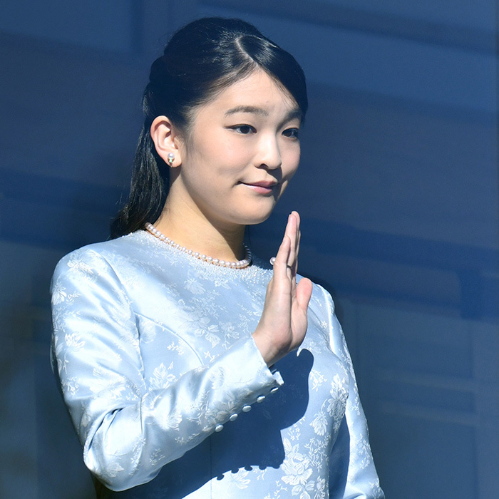 Wearing her signature pearls, Emperor Akihito and Empress Michiko's granddaughter Princess Mako, 26, waved from the Imperial Palace balcony during the New Year's greeting. The future royal bride is set for an eventful 2018, as she plans to give up her royal status to the throne after marrying law clerk Kei Komuro in November.