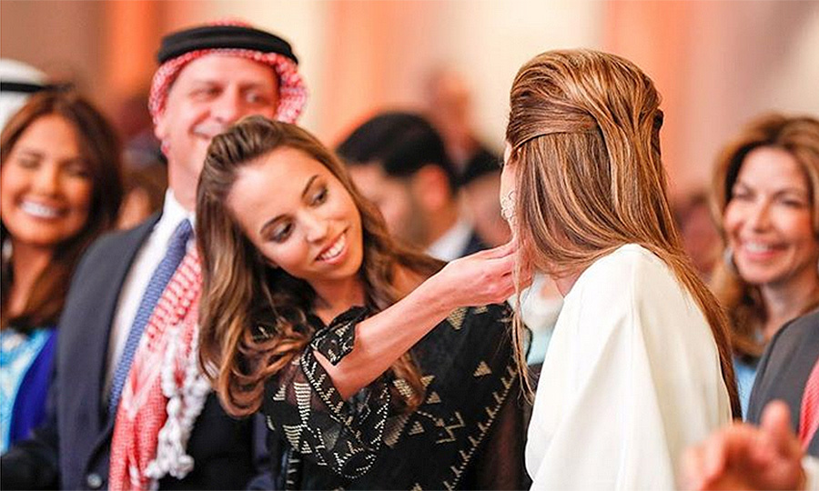 Queen Rania of Jordan must have been in a nostaligic mood, sharing this sweet mother-daughter throwback photo where 21-year-old Princess Iman takes a closer look at her earrings. The picture was taken before Jordan's 71st Independence Day celebrations kicked off last year.