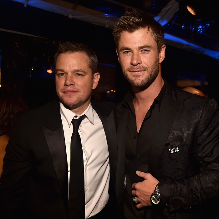 Matt Damon took a break from dancing with his wife to pose with Chris Hemsworth at the Amazon Studios party that was sponsored by Audi.