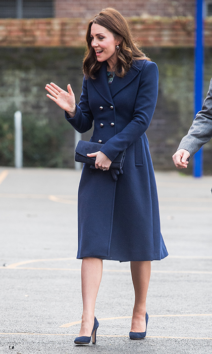 The Duchess of Cambridge wore a Hobbs navy blue coat over the Seraphine dress during what was her first official public engagement of 2018. The royal teamed the coa with matching Jimmy Choo high heels. 