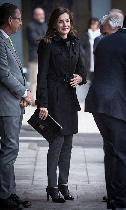 Queen Letizia of Spain braved the brisk weather in Madrid wearing a cool but classic look: a black trench, high heeled Lula booties and an envelope clutch by Hugo Boss. The royal was attending a meeting at Fundeu BBVA on January 10.