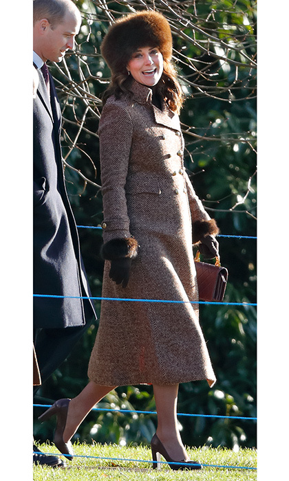 For her church visit with the royal family in Sandringham on January 7, Duchess Kate covered her baby bump in a recycled coat from Moloh that we also saw her wear back in 2014. The royal accessorized with a Lacorine hat and Chanel purse. 