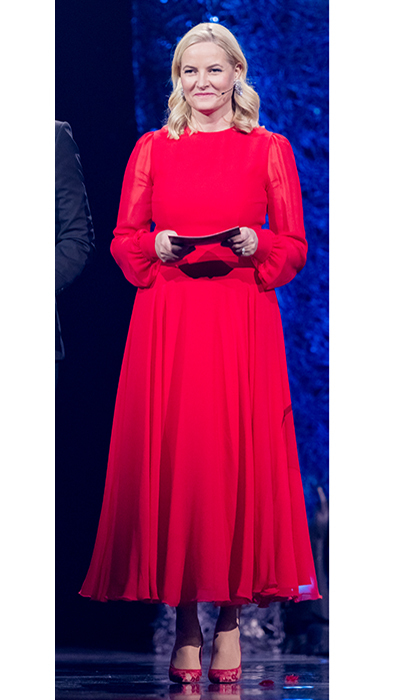 Future queen Crown Princess Mette-Marit of Norway was a royal lady in red, wearing this long-sleeved chiffon look as she presented a prize at the Sport Gala Awards at the Olympic Amphitheater in Hamar, Norway on January 6. 