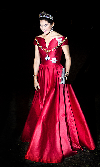 Crown Princess Mary of Denmark started off 2018 in style wearing a silk satin gown in regal red and a gorgeous tiara for the New Years reception at Amalienborg palace.