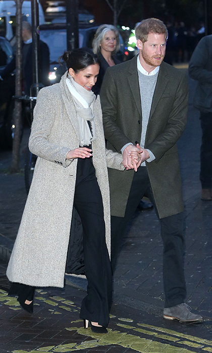 When the royal pair went on a visit to the Brixton district of London in January 2018 – just their second official royal engagement together –  Prince Harry stayed close to his fiancée, hanging on to her with not one but two hands as they departed.