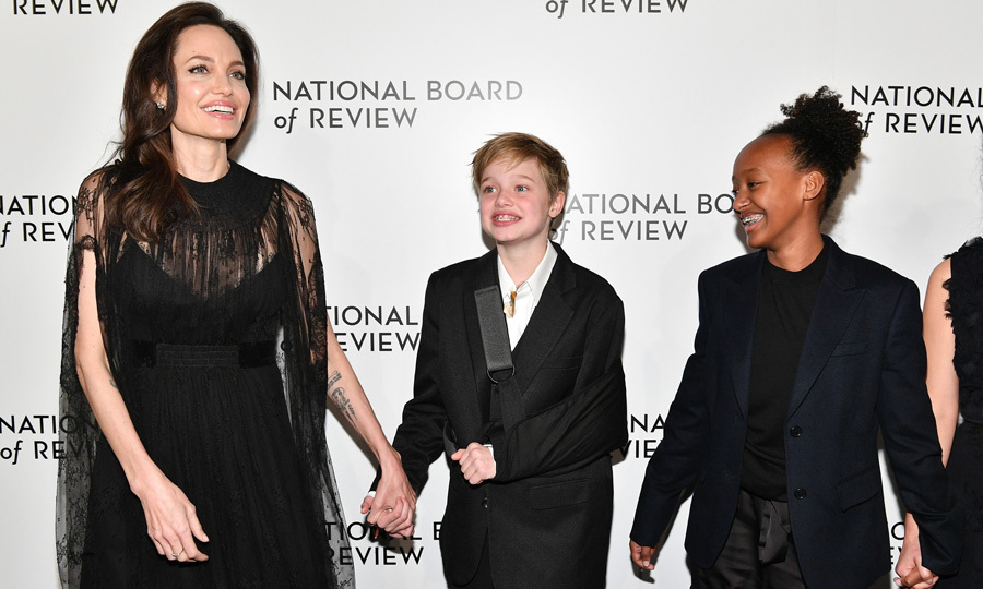 Angelina Jolie brought daughters Shiloh and Zahara to the National Board of Review. While all three dressed in black, her 11-year-old daughter sported an extra accessory — a cast after she fell during a winter vacation in Lake Tahoe, California over the holidays.