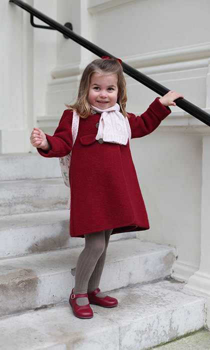 Her Royal Cuteness! In January 2018, Kensington Palace released photos of Princess Charlotte the morning of her first day at the Willcocks Nursery School. The photo, which was taken by Charlotte's mother the Duchess of Cambridge, shows the youngster wrapped up in red Amaia kids Razorbil coat and a pink scarf as she smiles tentatively at the camera. 