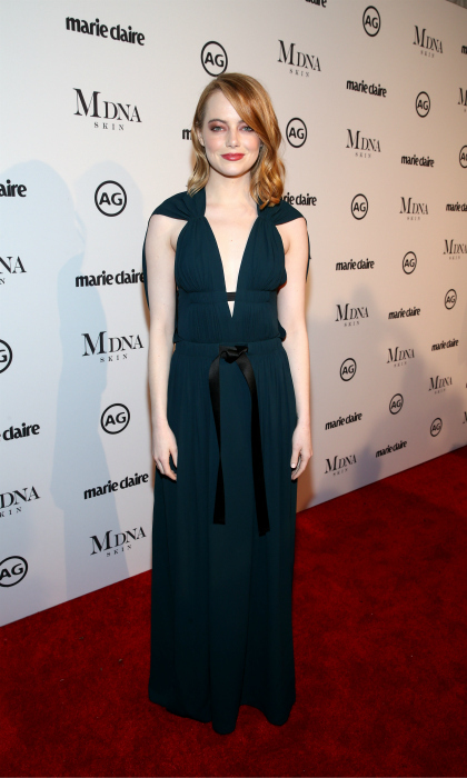 Emma Stone brought glamour to the event, rocking a plunging Louis Vuitton emerald dress. The 29-year-old Oscar-winner completed her Grecian-inspired look with dark red eyeshadow and wavy locks.