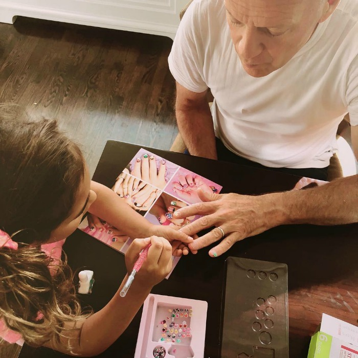 Emma Heming Willis showed off how great of a dad her husband Bruce Willis is on social media. The 62-year-old action star sat down and sweetly got a manicure done from his daughter Mabel (seen on the left). The daddy looked concentrated as his adorable 5-year-old girl adorned his nails.