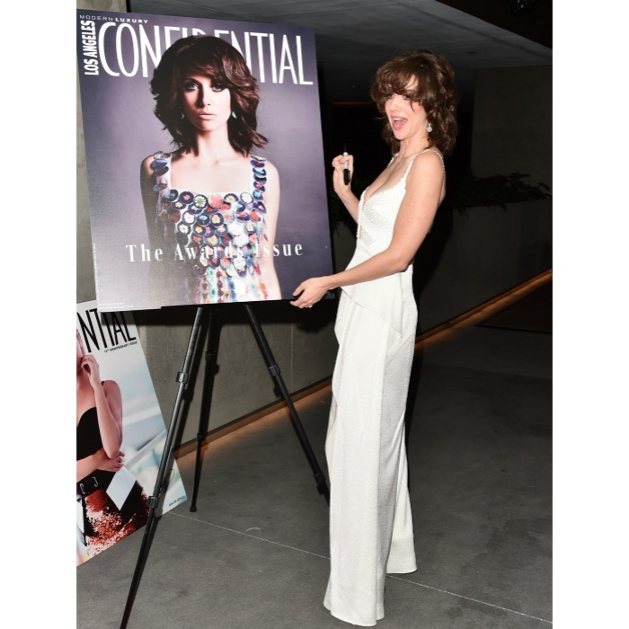 "Double the ""glow!"" Alison Brie brought the glam as she was honored at the Los Angeles Confidential Magazine's ""Awards Issue"" celebration on January, 13 at the Jeremy Hotel in West Hollywood, California. The 35-year-old actress said she went ""full bowie"" for her chic look: a white, silk jumpsuit and blown out hair.