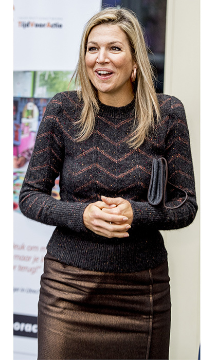 Queen Maxima played with texture in a grey knit top and bronze metallic skirt for a working visit to the Network for Action youth volunteer organization in Rotterdam on January 11. 