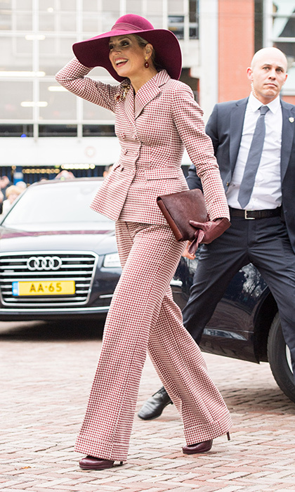 Queen Maxima of the Netherlands loves to have fun with fashion – and during a visit to Arnhem she showed off her flair in a 1970s-inspired wide-leg pantsuit. The Dutch royal's ensemble was styled like the disco era literally from head to toe, from her wide-brimmed hat to her platform heels. 