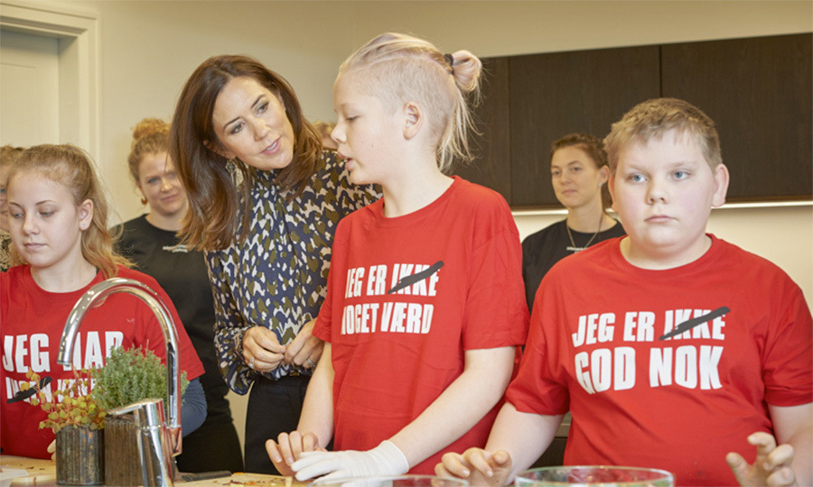 "Crown Princess Mary of Denmark stopped by the new ""Christmas Market-home"" for its inauguration. The Christmas Market homes aim to help children in need, who need help tackling bullying, loneliness and low self-esteem. The homes can house up to 48 children at a time.