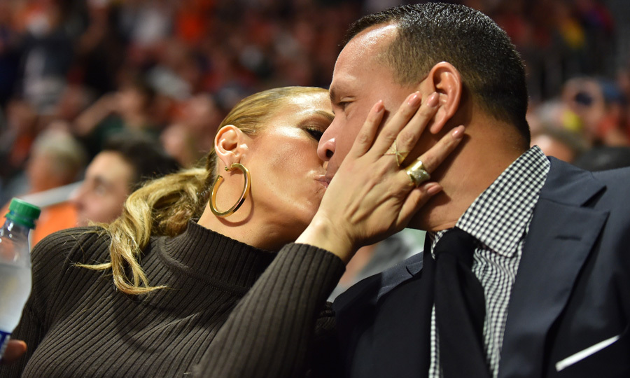 Between taking selfies and hanging with Alex's daughter, the couple was able to steal a quick kiss at the college basketball game.