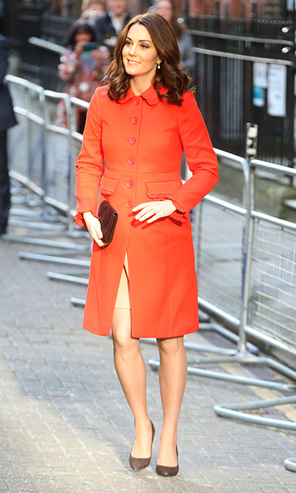 Quick change Kate! Earlier in the day the Duchess of Cambridge had shown off a dressier look, wearing a £220 ($305) coat from Boden for a visit to Great Ormond Street Hospital. The pregnant royal finished off the look with lovely Annoushka Baroque Pearl Drop earrings, nude stockings and a simple black clutch bag.