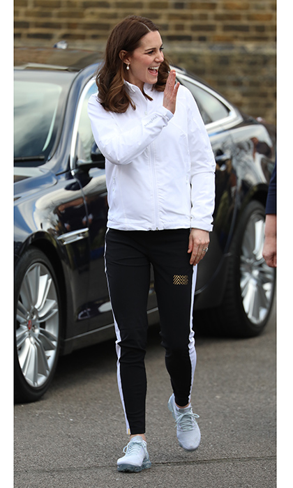 On January 17, Duchess Kate swapped her heels for sneakers as she stepped out for her sporty afternoon engagement in South-West London to see the work of the Wimbledon Junior Tennis Initiative at Bond Primary School in Mitcham. The 36-year-old – who is patron of the All England Lawn Tennis and Croquet Club – wrapped up warm in a white track jacket from Clarice, priced at £128 ($179), black leggings and Nike sneakers.