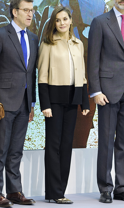 Queen Letizia of Spain helped her husband King Felipe kick off the FITUR International Tourism Fair in Madrid wearing some studded high heels by Uterqüe and a recycled two-tone coat BOSS Hugo Boss jacket in beige and black.