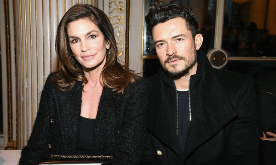 Front row fun! Cindy Crawford and Orlando Bloom sat next to each other at the Balmain Homme Menswear Fall/Winter 2018-2019 show as part of Paris Fashion Week on January 20 in France. Both of the stars looked stylish in black ensembles.