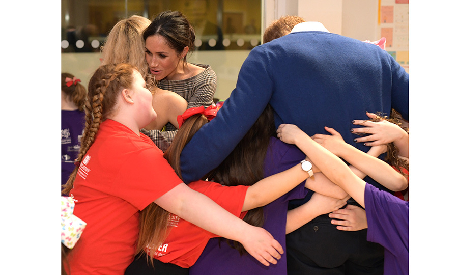 The royal couple shared the affectionate wealth, taking part in a group hug as they attended a street dance class at Cardiff's Star Hub community and leisure centre. 