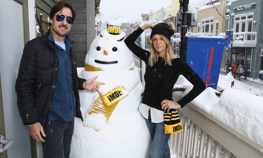 Luke Wilson and Kaitlin Olson of <i>Arizona</i> didn't let the snowstorm stop them from going outside to build a snowman at the IMDb Studio.  