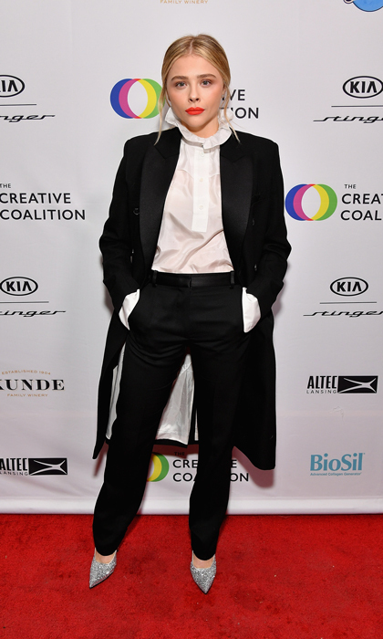 "Chloe Grace Moretz was sans boyfriend Brooklyn Beckham while attending the Creative Coalition's 2018 Spotlight Initiative Awards Gala Dinner at the KIA Supper Club though she did honor his mom by wearing a head-to-toe look by the designer. Chloe, who attended the festival to promote  <i>The Miseducation of Cameron Post</i>, accepted her award and shared: ""We made this film about a girl that gets sent to gay conversion therapy after being caught with a girl...and this is still legal in 45 out of 50 states."" She dedicated the award to the LGBT community. 