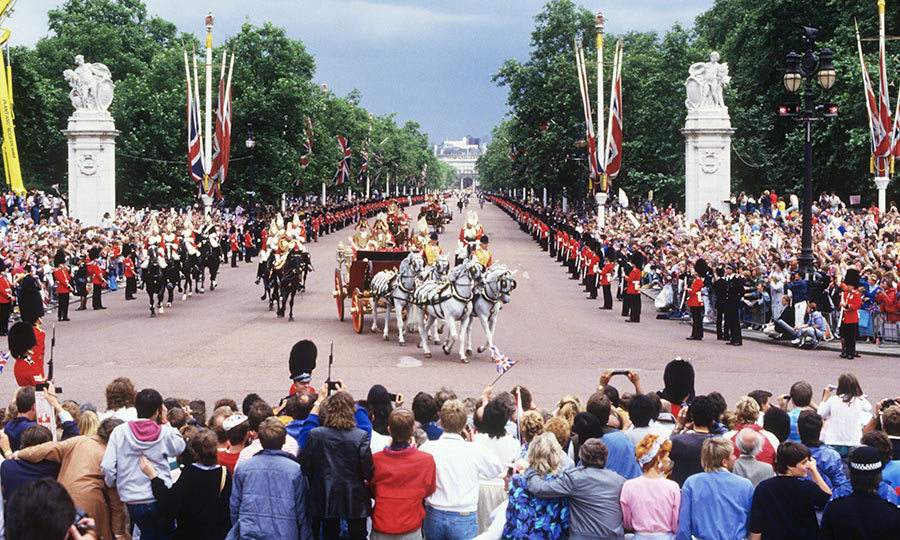 Throngs of well-wishers lined the streets as Sarah and Andrew made their way the Palace in the royal procession. A crowd of 100,000 would gather to see the couple's first public kiss husband and wife on the Palace balcony.