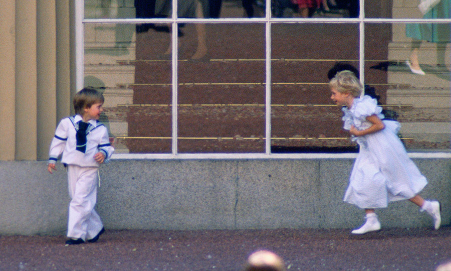 The scene at Buckingham Palace was a joyous one  – here little Prince William is pictured without his hat as he played with his eight-year-old royal cousin Lady Davina Windsor. 