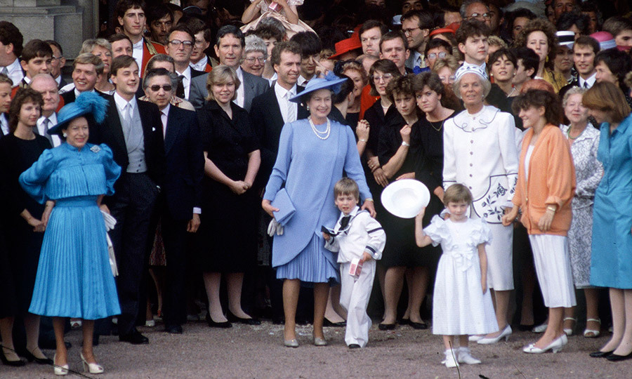 The royal family and household staff gathered to bid farewell to the Duke and Duchess of York as they headed off on honeymoon. Queen Elizabeth II has her arm around grandson Prince William, center, while on the left is Queen Elizabeth's sister Princess Margaret. 